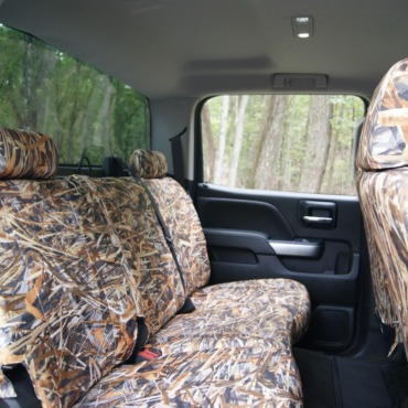 Chevy / GMC Truck with custom fit, waterproof, camo TigerTough seat covers.