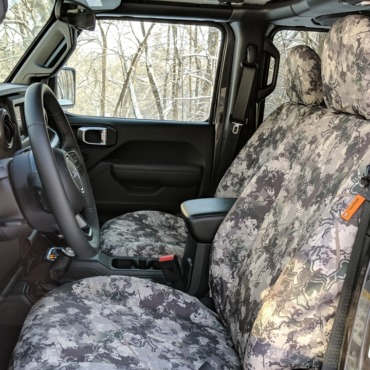 Jeep Wrangler JLU front seats with TigerTough seat covers in TrueTimber Western Viper.