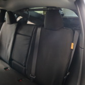 TigerTough Tactical Seat Covers on the rear seat of a Tesla Model Y